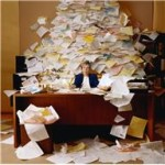 org - lady at desk overflowing w paper